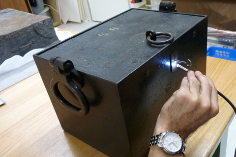 The locksmith inserts a blank key in order to gain an impression of the cut of the lock.