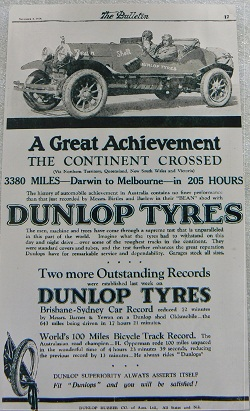 Black and white advertisement with an image of an two men sitting in an open-topped car. Below is printed text, some of which reads: 'A Great Achievement / THE CONTINENT CROSSED / 3380 MILES - Darwin to Melbourne - in 205 hours / DUNLOP TYRES'.