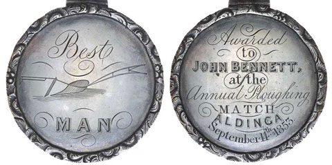 Image showing two faces of a circular medallion with a ring at the top. The face on the left is inscribed 'Best MAN' with an image of a plough. The right is inscribed with 'Awarded/to/John Bennett/at the/Annual Ploughing/Match/Aldinga/September 14th 1853'.