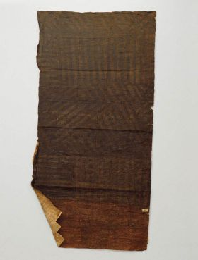 Part of a very large piece of barkcloth, with broad black stripes that stands out only slightly against the blackish-brown background.