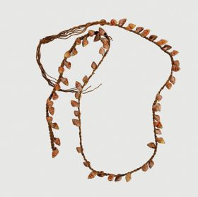 Necklace consisting of small red snail shells arranged onto a plaited string.