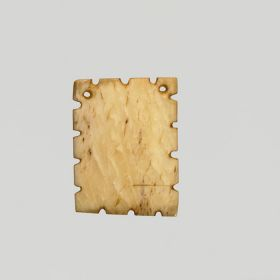 A flat square bone pendant with half notches on all sides and perforated at the corners.