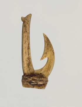 Fishhook, made of two pieces of bone bound together with a string made from plant materials. The barb is located on the inner side of the hook.