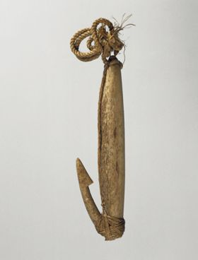 Fishhook made of two pieces of bone neatly tied together, with twisted cord and lashing made of plant material.