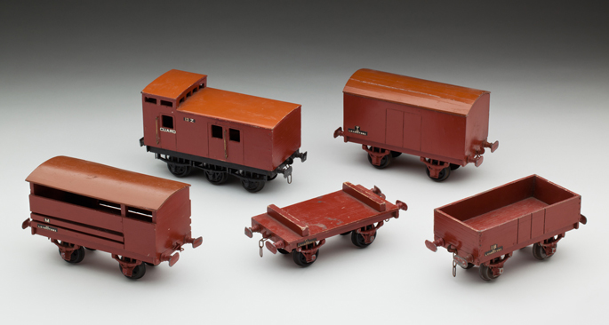 (l-r) Victorian Railways 'M' cattle van, 'Z' brake van, flat wagon, 'T' goods van and 'IB' open wagon, made from wood with lead composition and diecast wheels by John May and Alan Budge