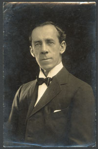 Sepia-toned photograph of white male wearing early twentieth century clothing.