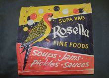 Colour photograph of a show bag with printed text 'Supa Bag, Rosella Fine Foods, Soups, Jams, Pickles, Sauces'.