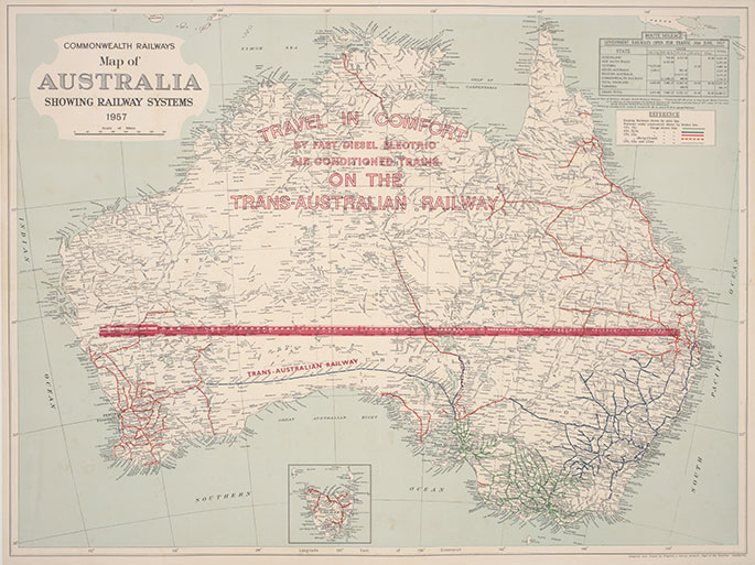 Map of Australia with a red stylised image of a train stretching from the east to west coasts. Printed over the top-end are the words 'Travel in comfort by fast diesel electric air conditioned trains on the Trans-Australian Railway.