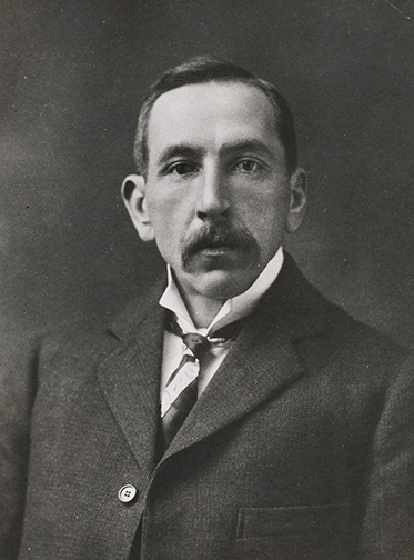 Studio portrait photo of an expressionless Billy Hughes.