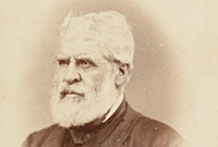 Daguerreotype of white-haired, bearded man in dark suit.