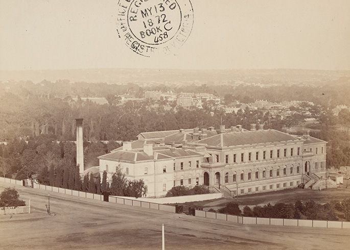 sepia-toned photograph of a large three-storey white building
