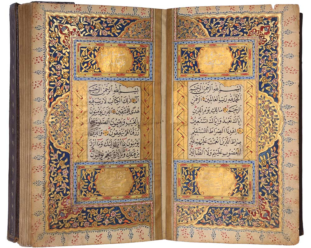 An ornate book made from paper, black ink, pigments, gilding, pasteboard and leather - click to view larger image