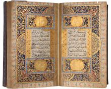 An ornate book made from paper, black ink, pigments, gilding, pasteboard and leather