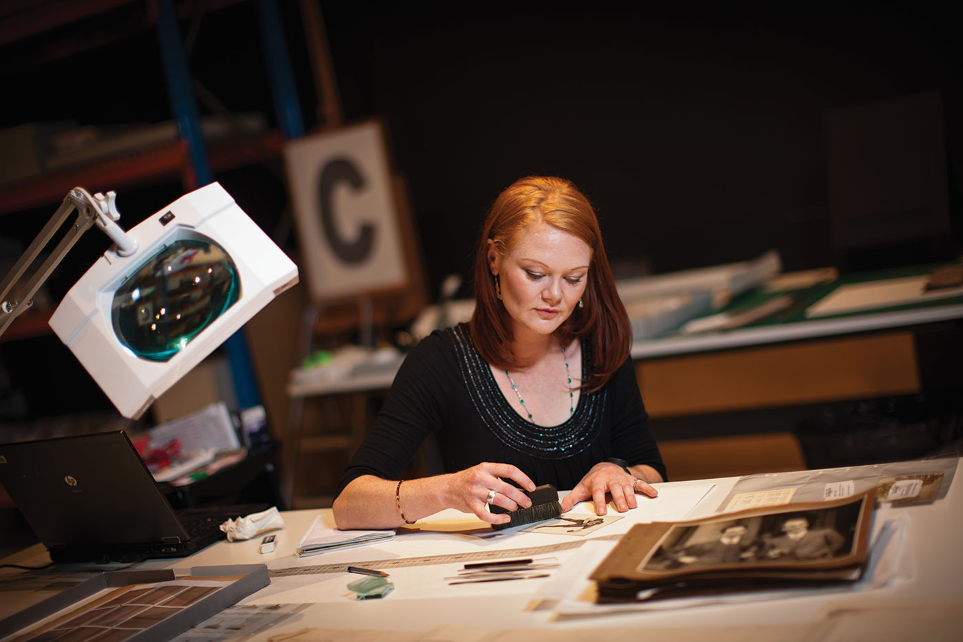 Conservator Jess Wignell at work during the Museum Workshop exhibition.