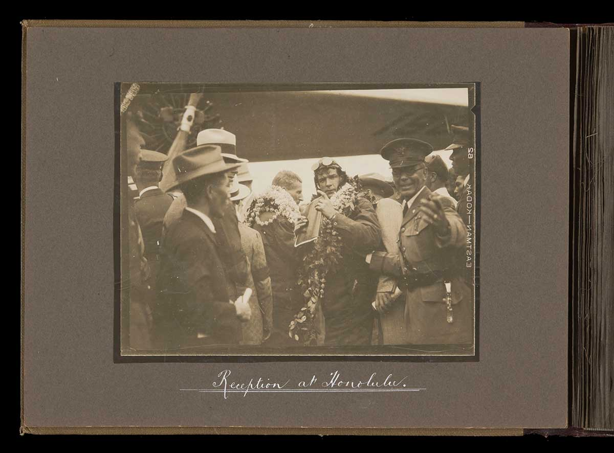 'Southern Cross' crew being welcomed on arrival at Honolulu. - click to view larger image