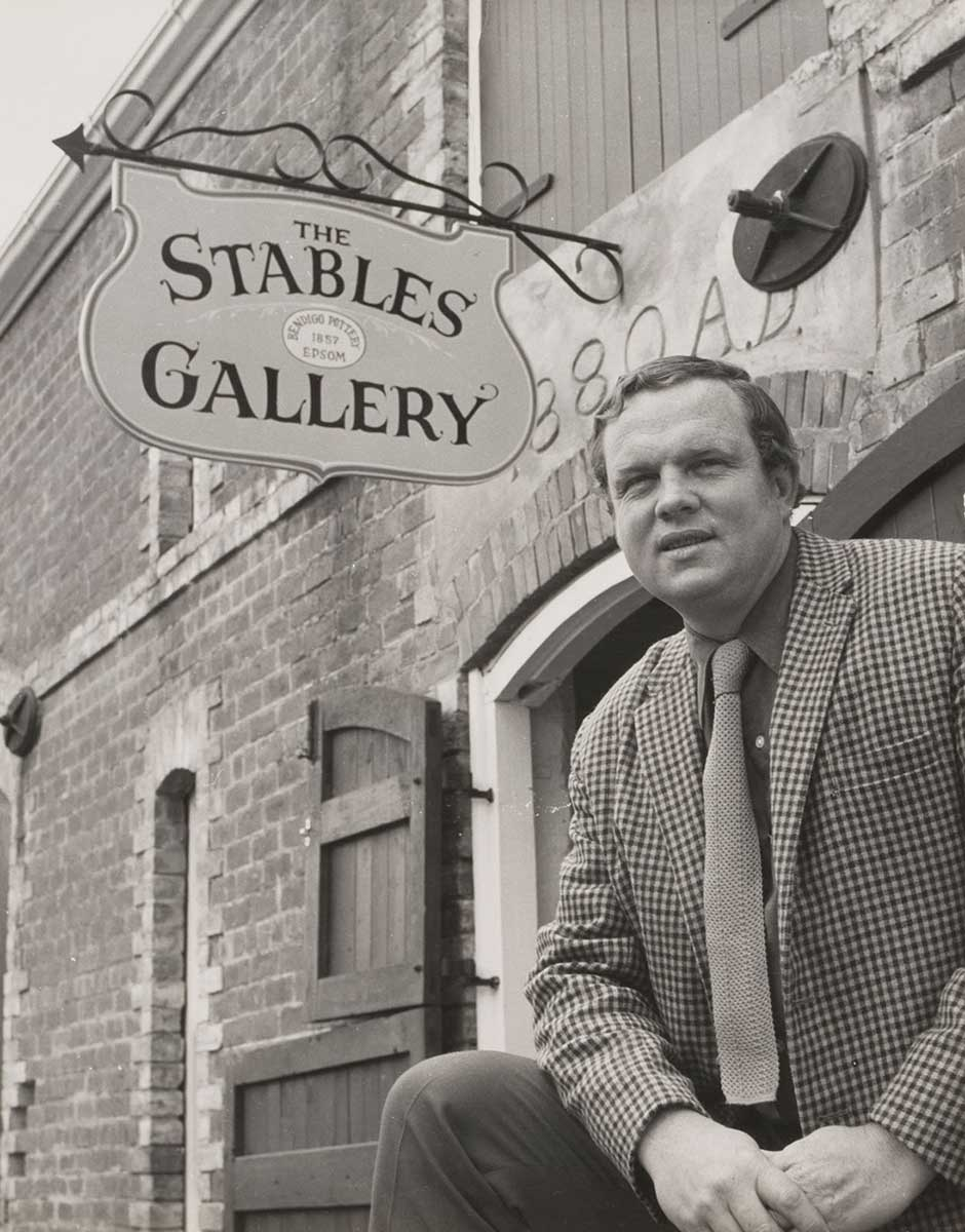 Photograph of Bill Derham in front of the Stables Gallery. - click to view larger image