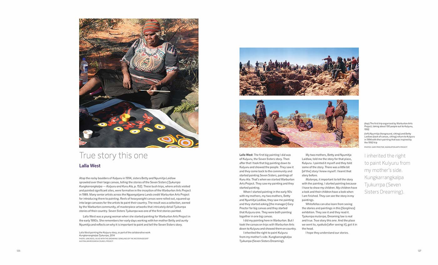 Songlines catalogue spread with text 'True story this one by Lalla West' and images of artists at work and a group visiting a desert site - click to view larger image