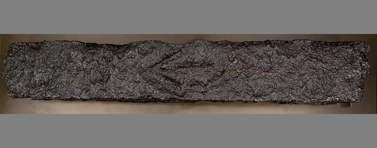 A long, rectangular-shaped metal bar with a pitted surface. - click to view larger image