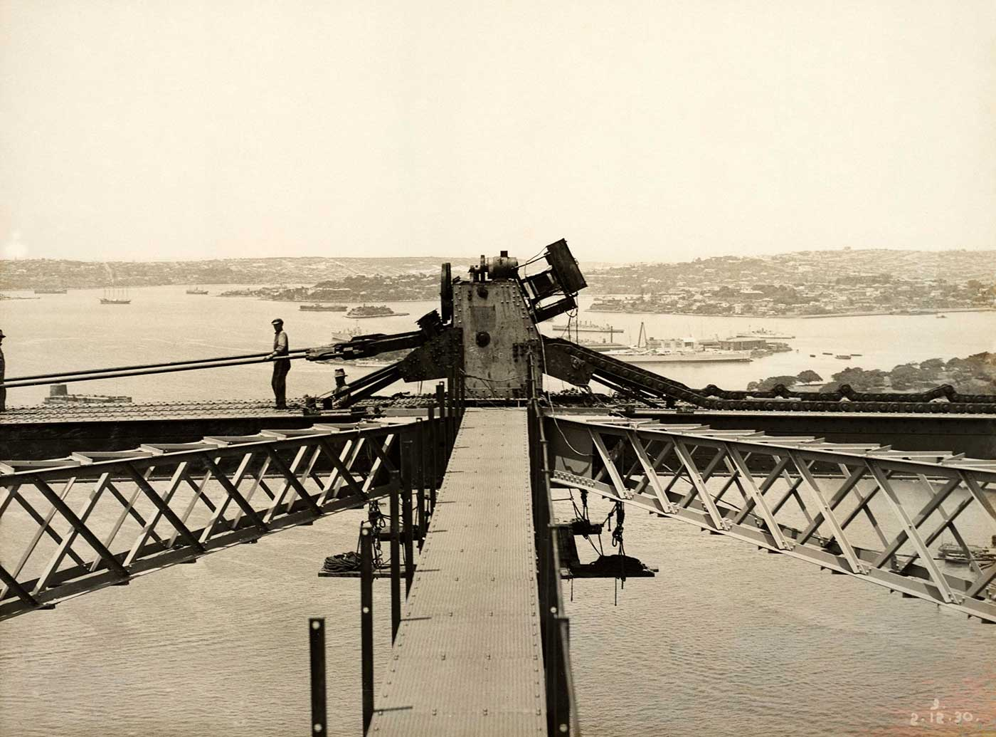 Workers on top of a section of the Sydney Harbour Bridge. - click to view larger image