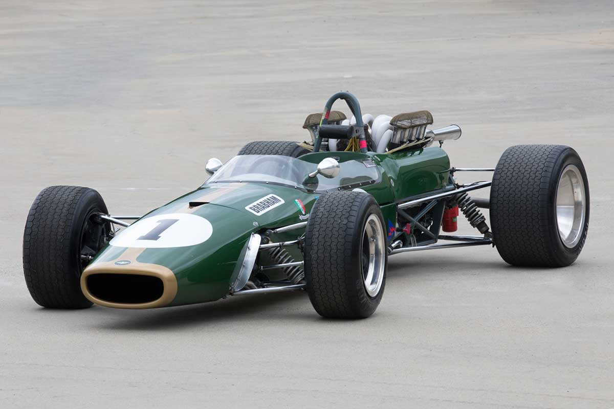 Dark green open-wheeled racing car. - click to view larger image