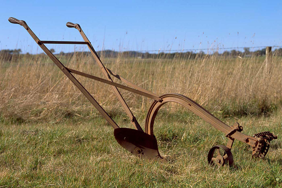 A horse-drawn plough in a paddock - click to view larger image