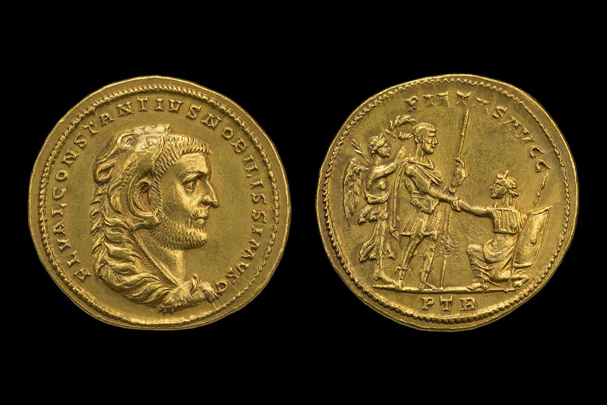 An image showing both sides of the gold medallion of Constantius. On the left is the side profile of a man, with Roman text around the edge. On the right is an image of one man knelling before another. - click to view larger image