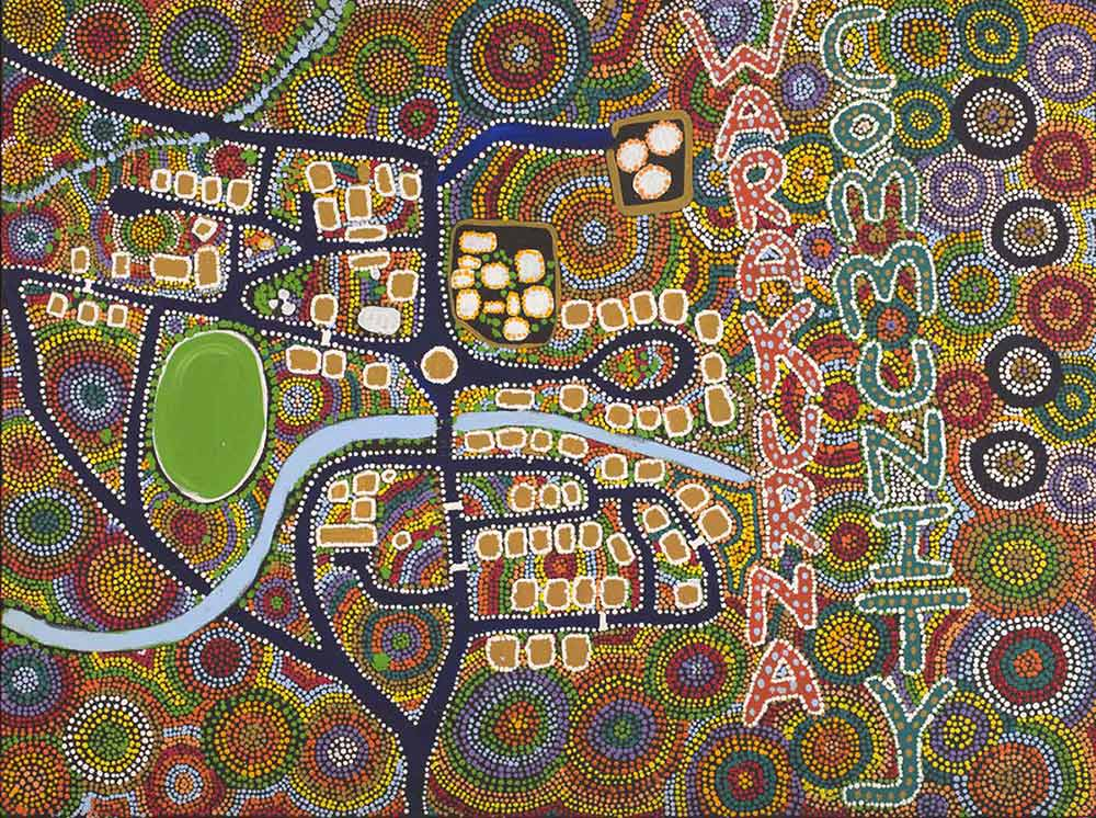 An acrylic painting on canvas showing an aerial view of a community in a multi-coloured landscape, with the text 'WARAKURNA COMMUNITY' written vertically alongside.  - click to view larger image