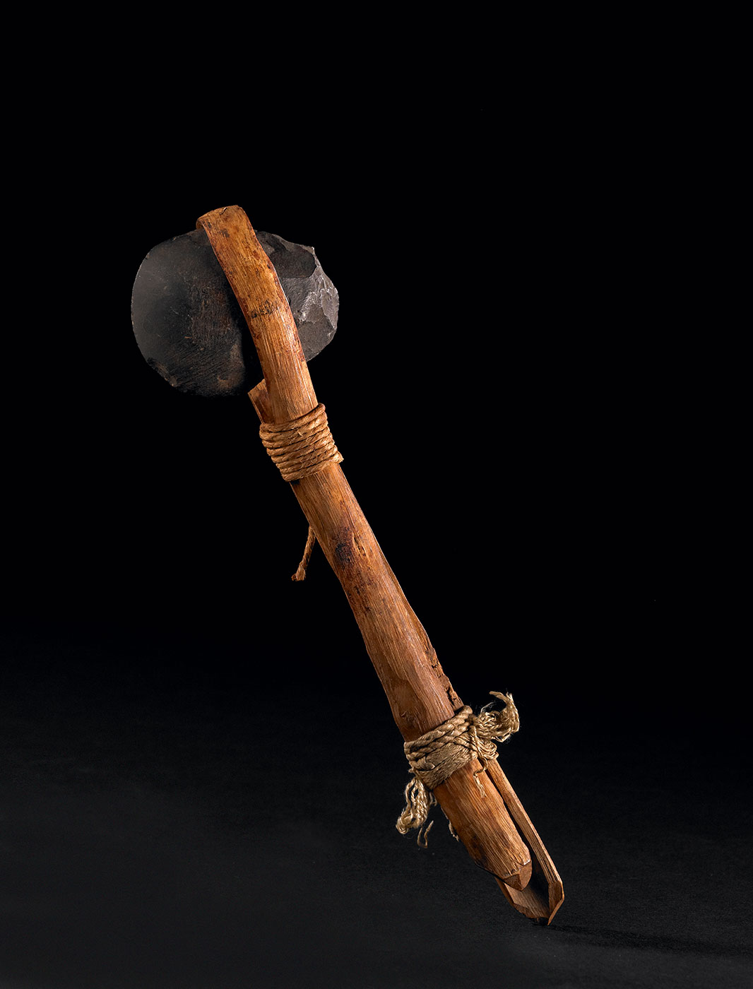 An axe made of stone, wood and rope. - click to view larger image