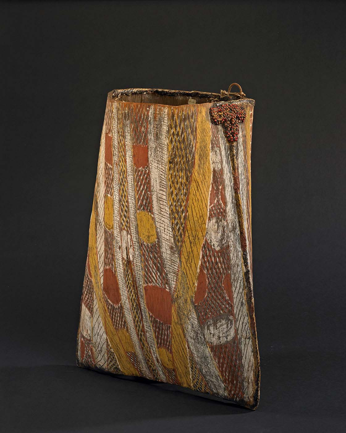 Basket made of folded bark with a geometric design painted with pigment. - click to view larger image