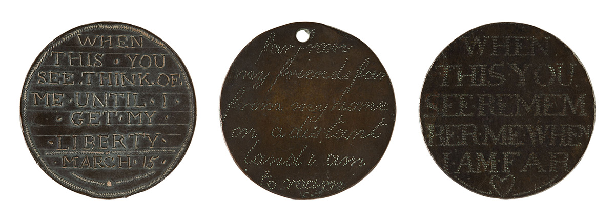 Three small discs hand engraved with text that reads, 'When this you see think of me until I get my liberty', 'Far from my friends far from my home on a distant land I am to roam' and 'When this you see remember me'.