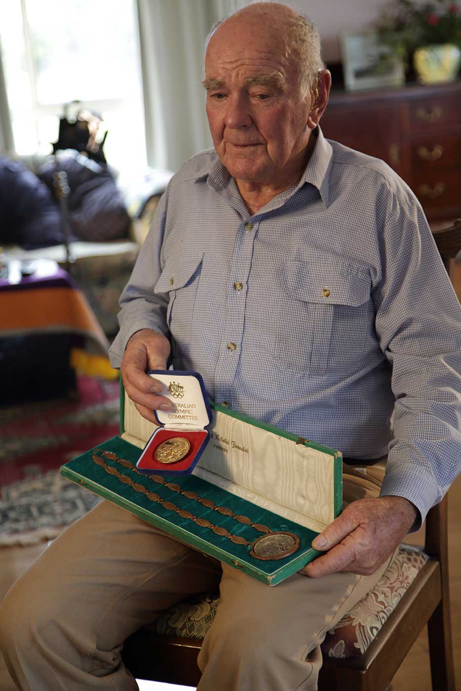 Neale Lavis with his two medals from the Rome Olympics, 1960.  - click to view larger image