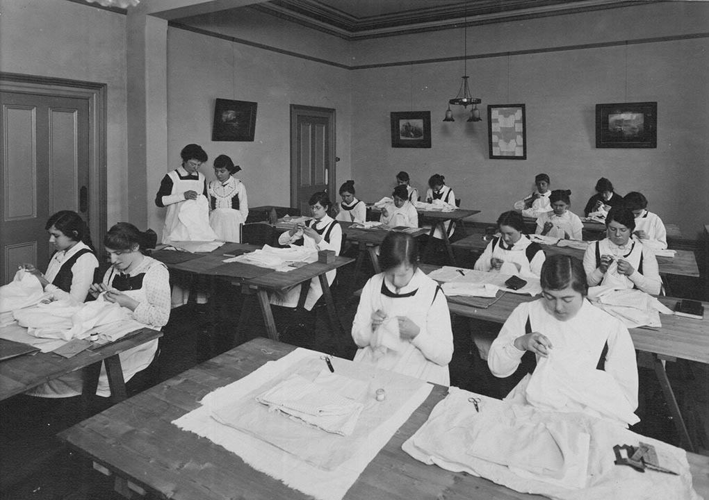 An old black and white photo of a needlework class - click to view larger image