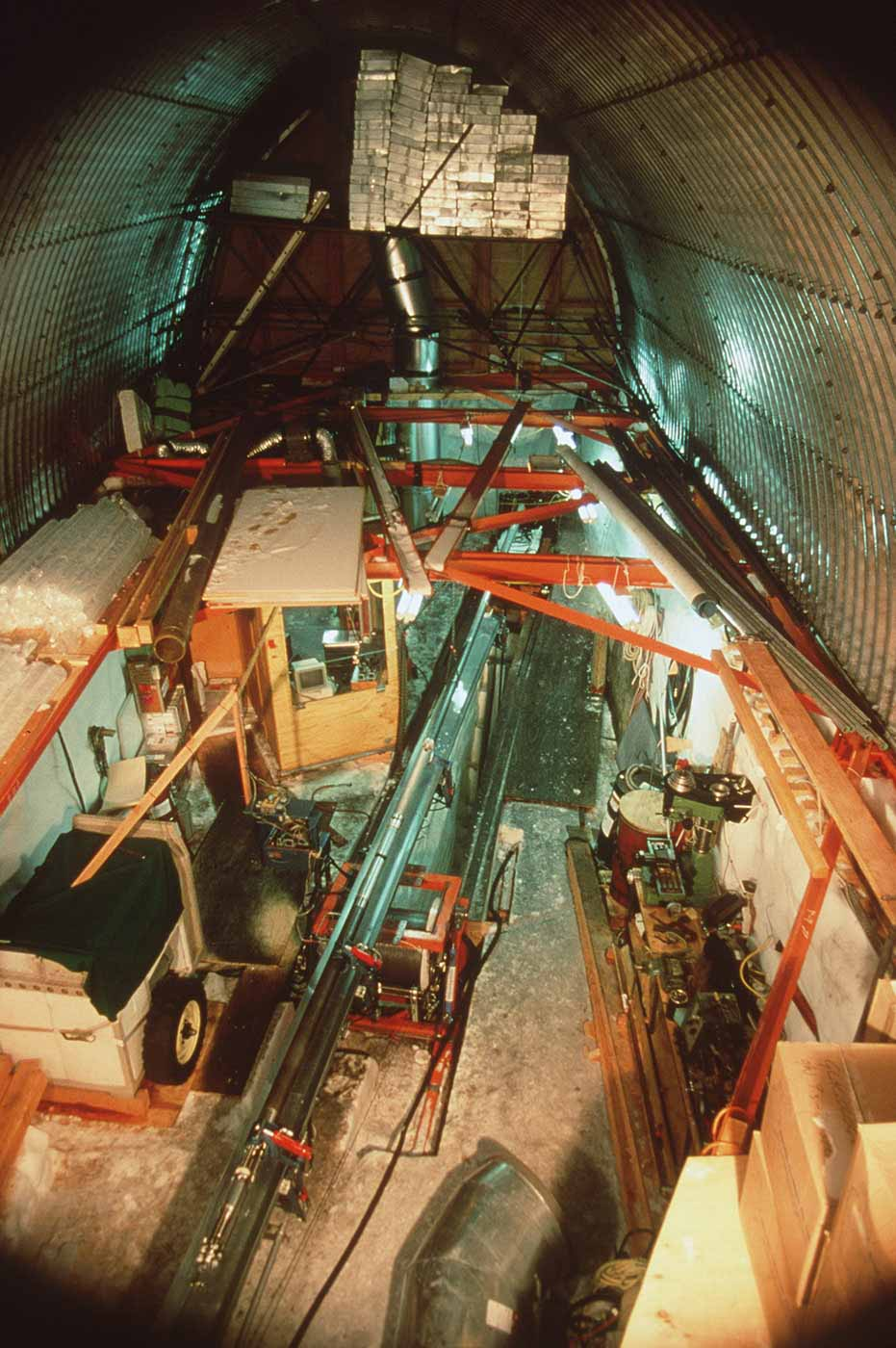 Construction site in a tunnel containing machinery and equipment. - click to view larger image