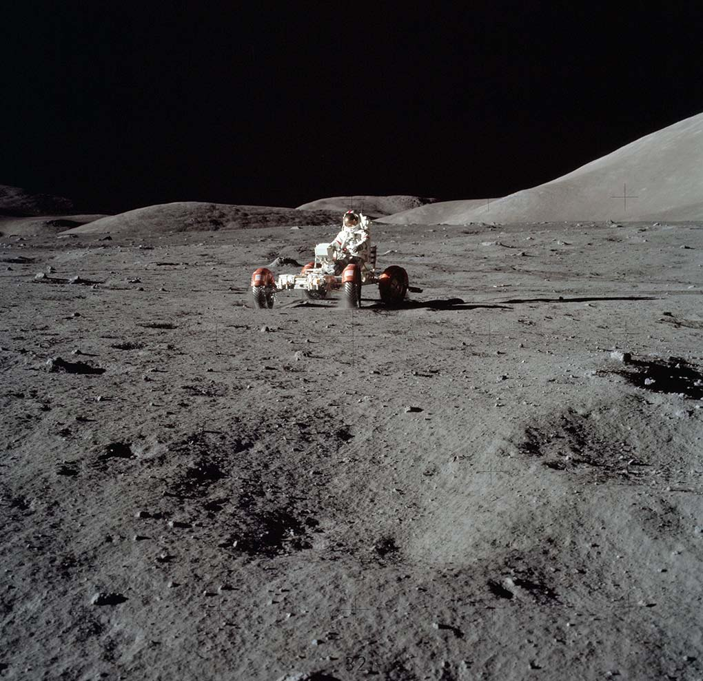 A photograph featuring an astronaut operating a vehicle on the Moon's landscape. - click to view larger image