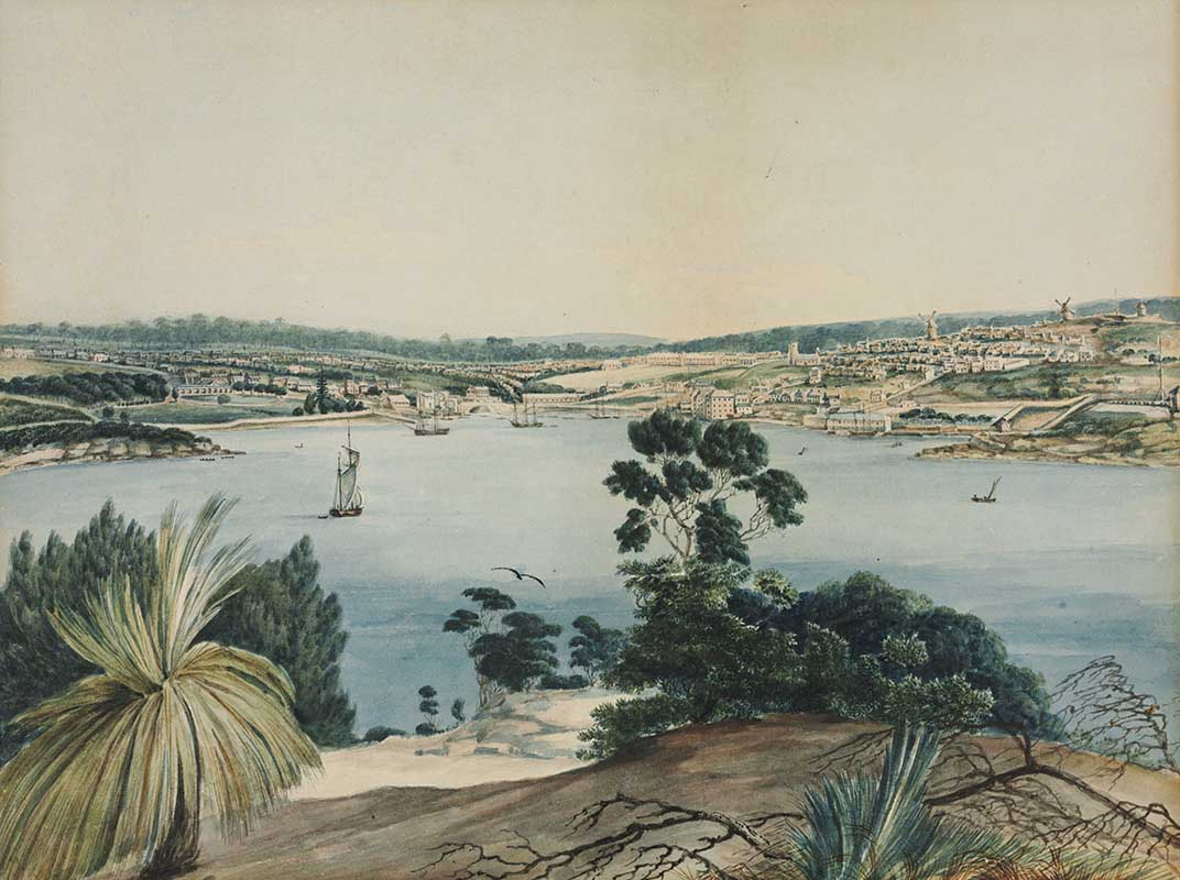 A painting featuring a body of water, a few small vessels in the background, surrounded by a landscape filled with palm trees and other kinds of plant life.