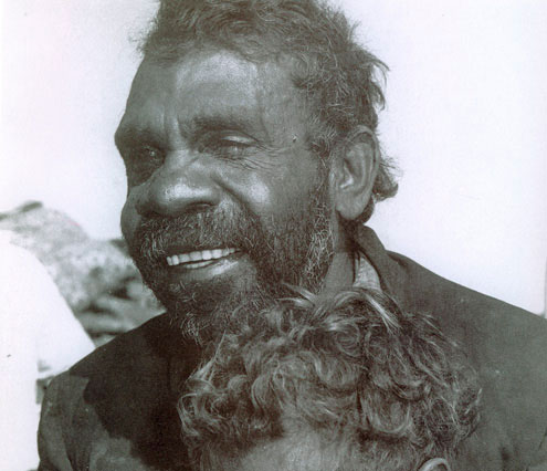 Portrait photo of an Aboriginal Australian man.