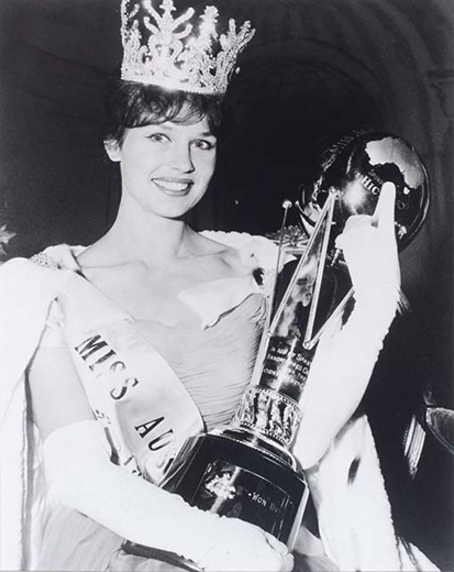 Miss Australia 1961, Tania Verstak holding the Miss Australia trophy, wearing the crown, robe and white gloves - click to view larger image