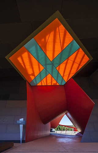 An architectural feature with a large orange filled diamond shape with a teal coloured cross through the middle.