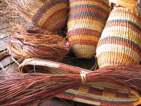 Multi-coloured striped woven basketry works by Helen Guyula Djaypala.