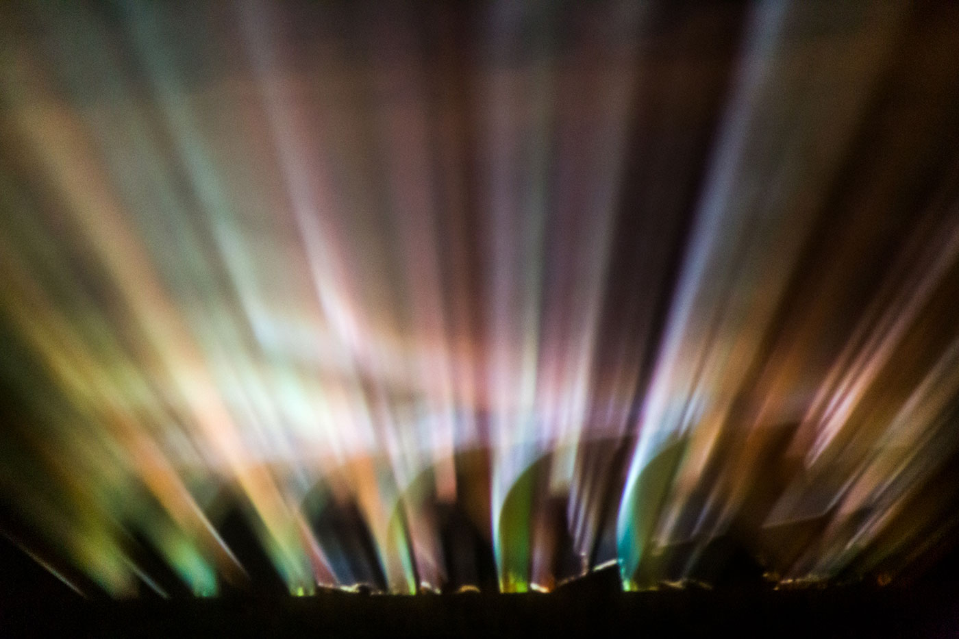 An image of an eight furrow stump-jump plough (about 1940) is projected onto fog, 2015 - click to view larger image