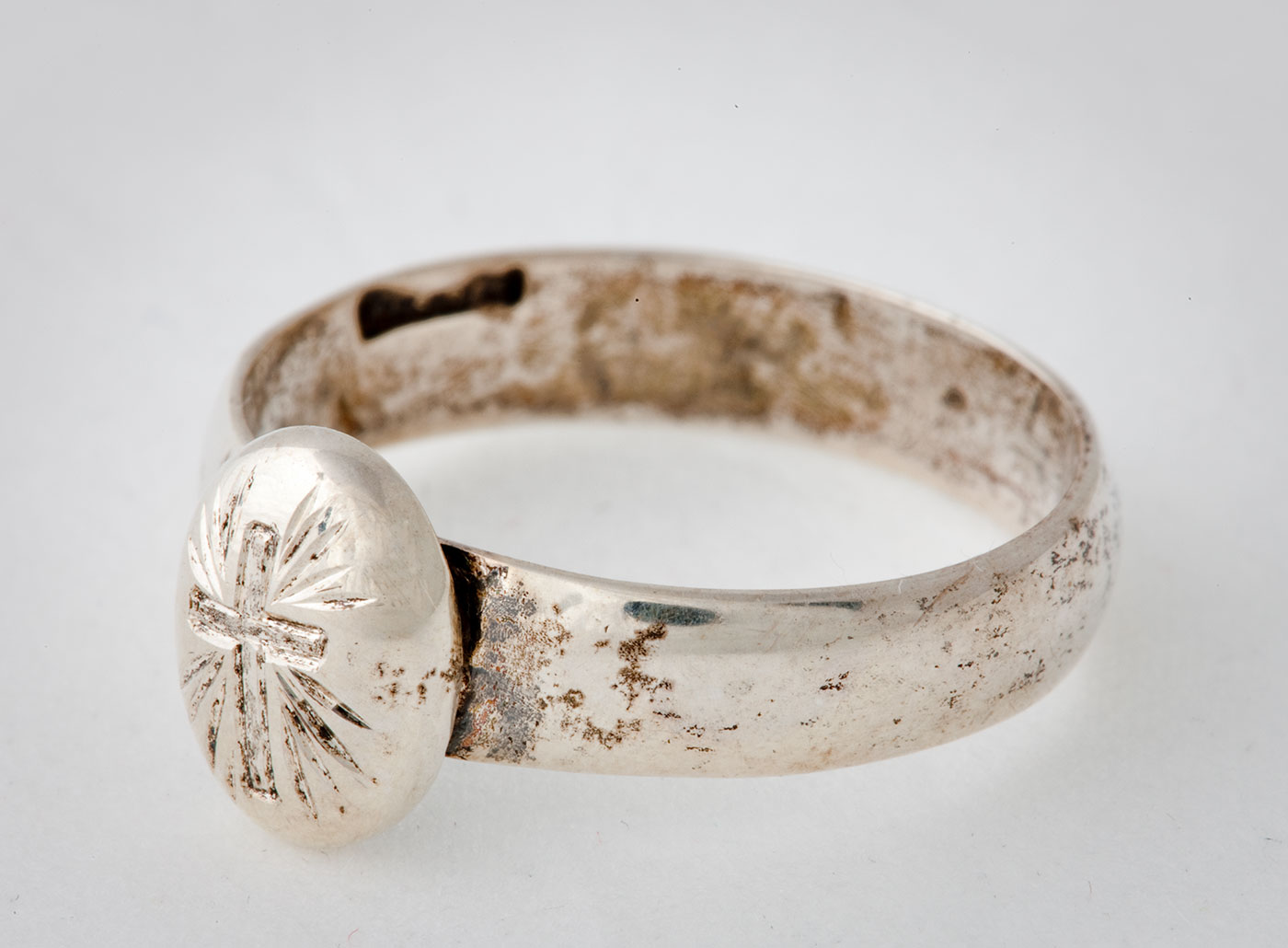 Silver ring with cross inscription. - click to view larger image