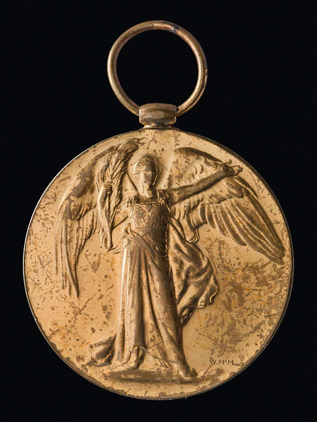 Gold medal embossed with an angel. - click to view larger image