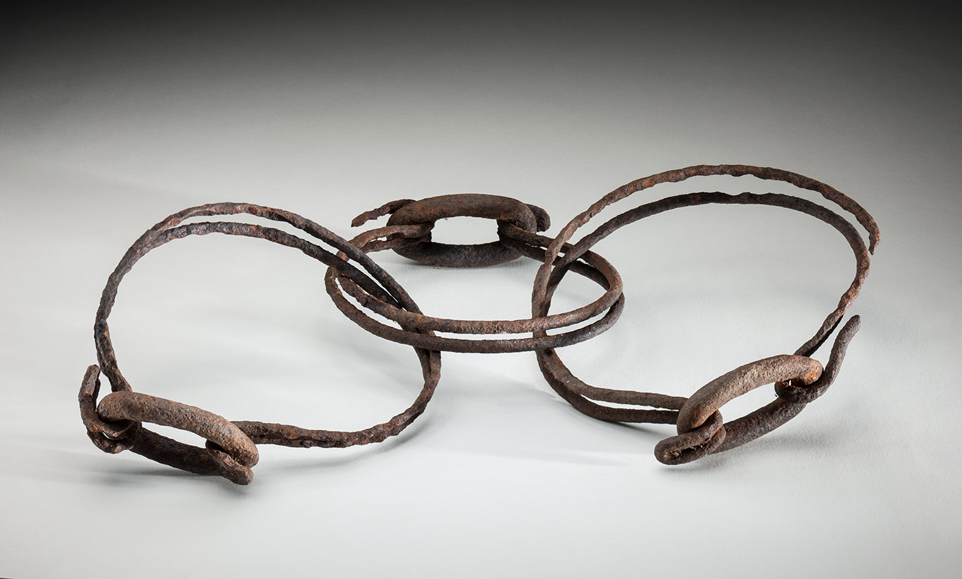 Two larger rusted wire rings joined by a smaller, central ring.