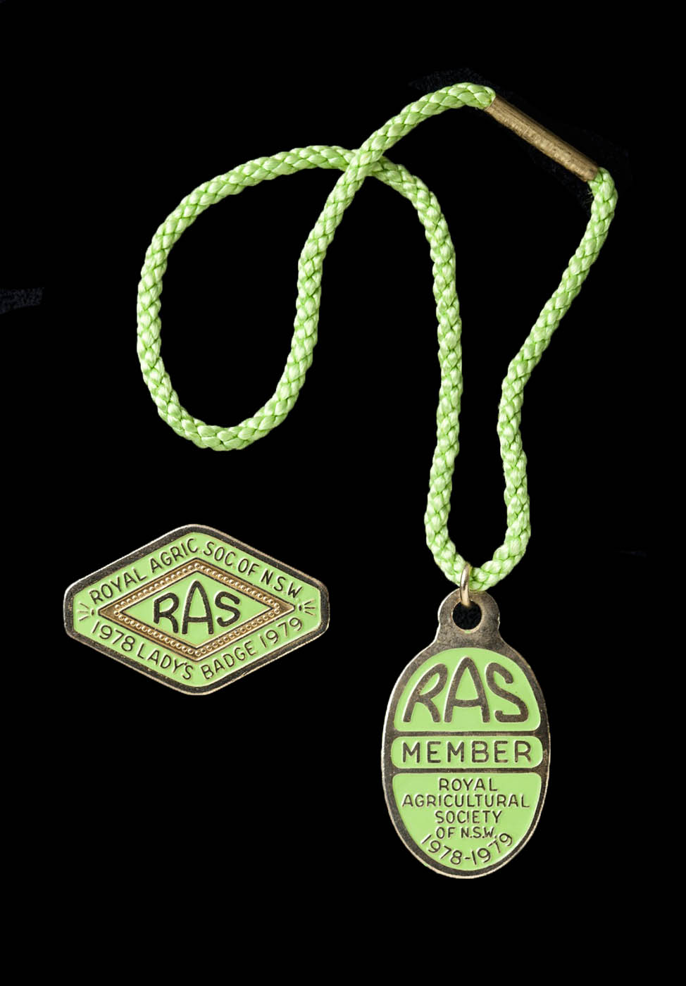 Royal Agricultural Society of N.S.W. members badge, attached to a green cord, and ladies badge, 1978-79 - click to view larger image