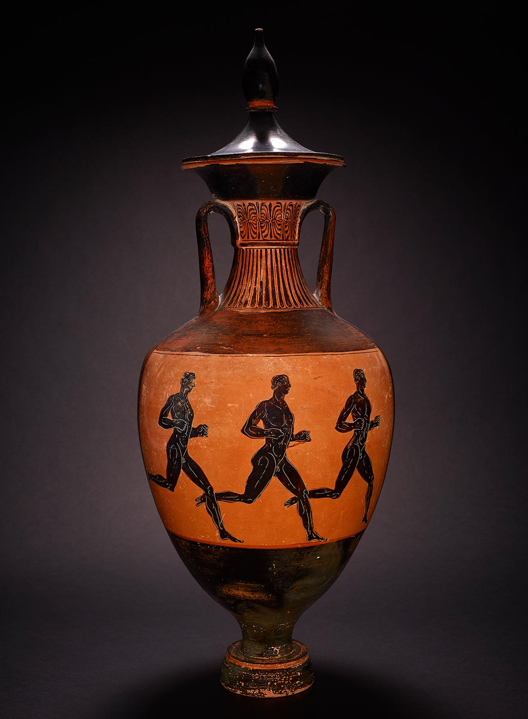 A two-handled narrow necked vessel with representations of running figures painted around its side. - click to view larger image