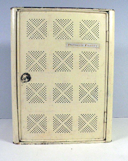 A cream painted upright rectangular metal meat safe featuring perforated sides, a handle on the top and a broken latch on the front hinged door. A plaque on the front of the door reads: 'Portable Pantry'.