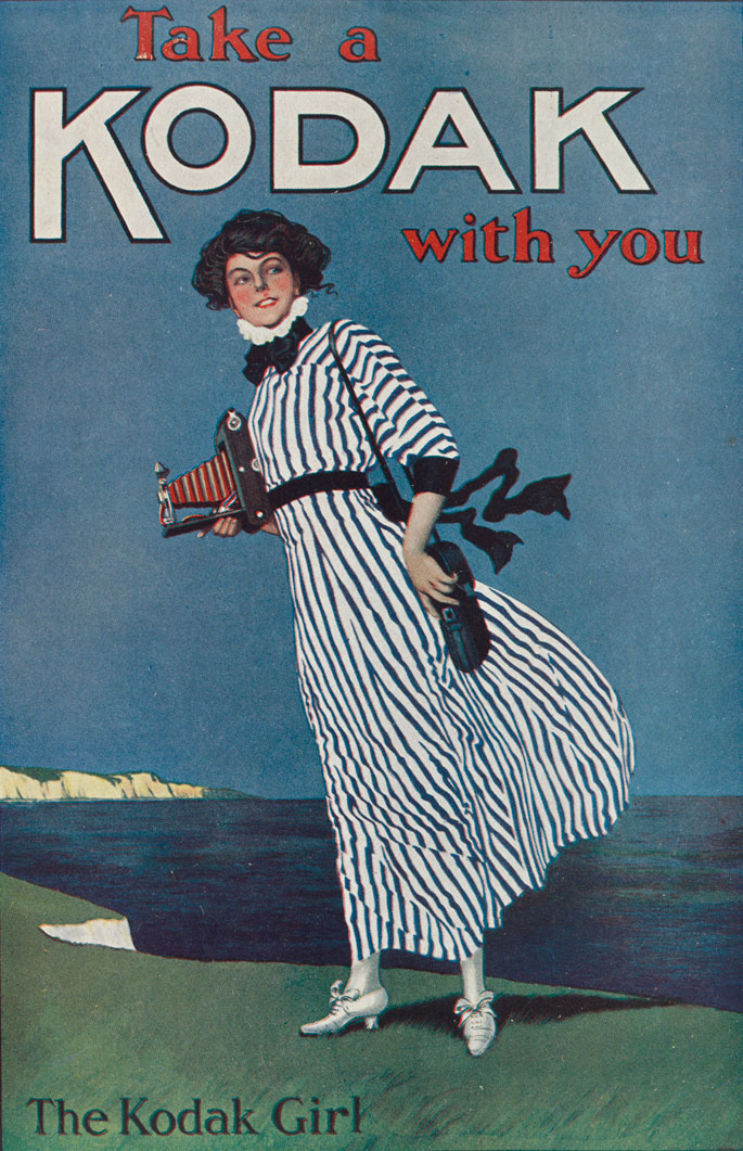A poster featuring a woman wearing a striped dress and holding a Kodak camera.  Text at the top reads 'Take a Kodak with you'. Text at the bottom reads 'The Kodak Girl'.