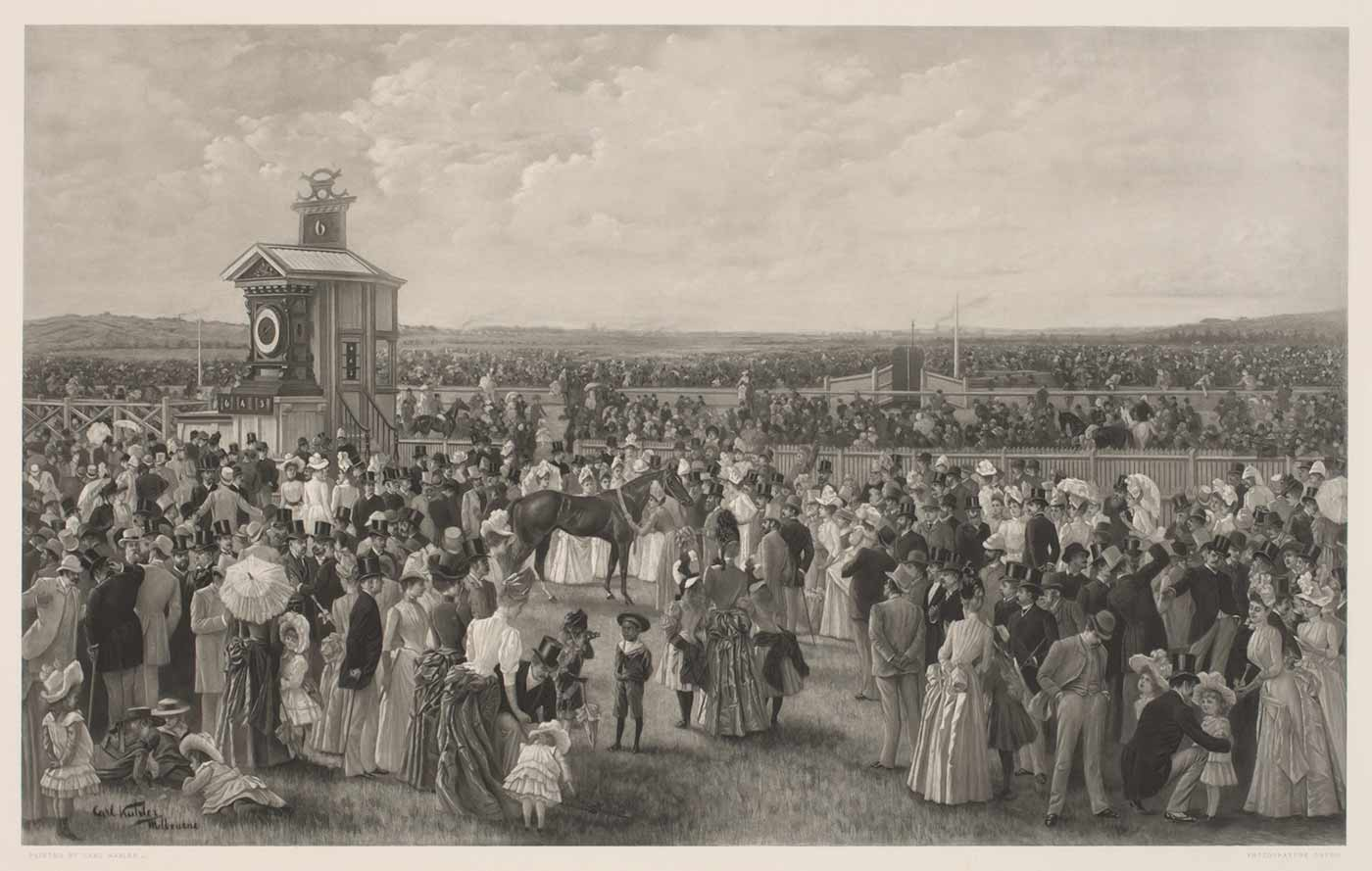 Black and white print showing a crowd of people at a horseracing track. Many people face a striking, dark racehorse which is being paraded at centre. The track and finishing post form the backdrop.  - click to view larger image