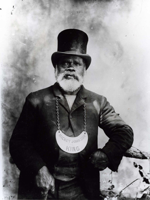 Black and white photograph of a man wearing a breastplate. - click to view larger image