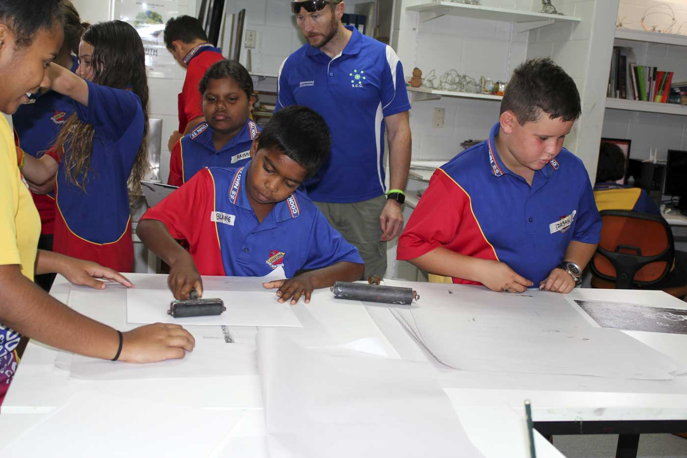 Primary school students attend a print making class. - click to view larger image